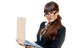 Señora del asunto con la computadora portátil Foto de archivo libre de regalías