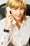 Señora del asunto en el teléfono Imagen de archivo libre de regalías