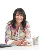 Señora del asunto maduro en oficina Imagen de archivo libre de regalías