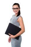Señora del negocio que sostiene ficheros de la oficina Imagenes de archivo