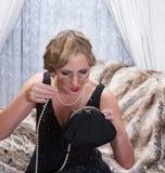 Señora del vestido de la aleta con impertinentes Imagen de archivo
