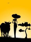 Señora derecha con la vaca Imagenes de archivo