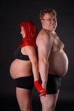 Señora embarazada con el hombre gordo Foto de archivo libre de regalías