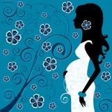 Señora embarazada en flores Imagenes de archivo