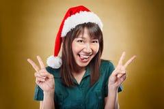 Señora emocionada con el sombrero de santa Fotografía de archivo libre de regalías
