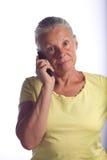 Señora en el teléfono Foto de archivo libre de regalías