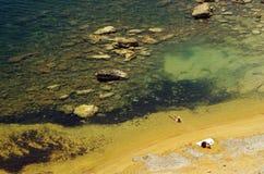 Señora en la playa Foto de archivo libre de regalías