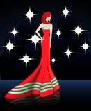 Señora en vestido largo rojo elegante Foto de archivo libre de regalías