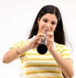 Señora feliz con el clarinet Fotografía de archivo libre de regalías