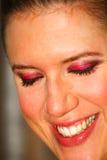 Señora feliz con maquillaje foto de archivo