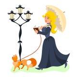 Señora hermosa joven que camina con su gato y libro de lectura imagen de archivo