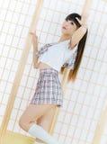 Señora japonesa de la muchacha del estudiante en animado del asiático del sitio del tatami Imagen de archivo