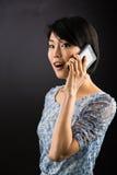 Señora japonesa en el teléfono elegante Fotografía de archivo libre de regalías