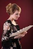 Señora joven con el ventilador Fotografía de archivo