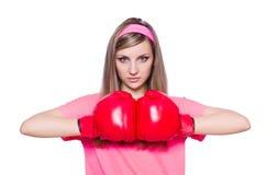 Señora joven con los guantes de boxeo Fotografía de archivo libre de regalías