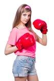Señora joven con los guantes de boxeo Imagen de archivo