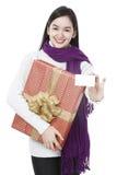 Señora joven con un presente Foto de archivo libre de regalías