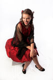 Señora joven coqueta en un vestido rojo Imagen de archivo libre de regalías
