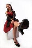 Señora joven coqueta en un vestido rojo Fotos de archivo libres de regalías