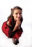 Señora joven coqueta en un vestido rojo Foto de archivo libre de regalías