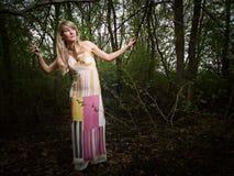 Señora joven en bosque Imágenes de archivo libres de regalías