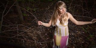 Señora joven en bosque Foto de archivo libre de regalías