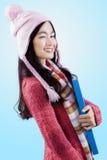 Señora joven en guiño de la ropa del invierno Imagen de archivo