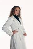 Señora joven en la chaqueta blanca Imagen de archivo