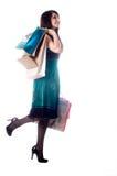 señora joven hacia fuera que hace compras. Fotos de archivo libres de regalías