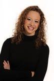 Señora joven hermosa en suéter negro Imagenes de archivo