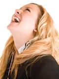 Señora joven que celebra su éxito Imagen de archivo libre de regalías