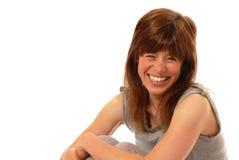 Señora joven que ríe nerviosamente Foto de archivo