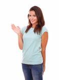 Señora latina tímida con la mano del saludo Fotografía de archivo
