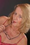 Señora madura con los vidrios Foto de archivo