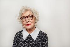 Señora mayor de Dreamful que expresa emociones positivas Fotografía de archivo libre de regalías