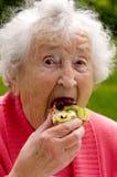 Señora mayor Eating A Waffle Foto de archivo libre de regalías