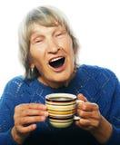 Señora mayor feliz con café Imagen de archivo