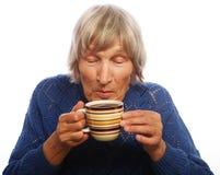 Señora mayor feliz con café Fotografía de archivo libre de regalías