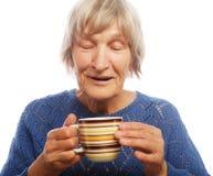 Señora mayor feliz con café Imagen de archivo libre de regalías
