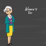 Señora mayor para la celebración del día de las mujeres internacionales Imágenes de archivo libres de regalías