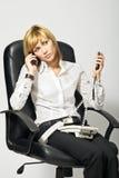 Señora ocupada del asunto en el teléfono Fotos de archivo
