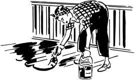 Señora Painting Patio Floor Fotografía de archivo
