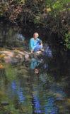 Señora por The Creek Foto de archivo