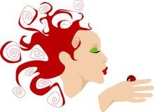 Señora que besa el ladybug Foto de archivo libre de regalías