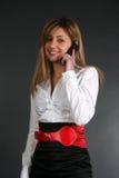 Señora que habla por el teléfono Imagen de archivo