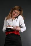 Señora que habla por el teléfono Imágenes de archivo libres de regalías