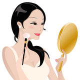 Señora que hace maquillaje Fotos de archivo