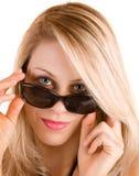 Señora rubia hermosa Looking Over Sunglasses fotografía de archivo libre de regalías