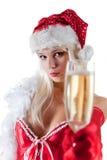 Señora Santa que estira el vidrio del champán Fotos de archivo libres de regalías