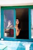 Señora sensual de la ventana Imágenes de archivo libres de regalías